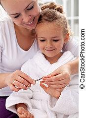 Cutting fingernails after bath