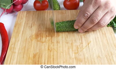 Cutting fresh cucumber