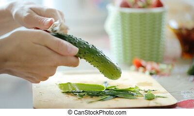 Cutting fresh cucumber for salad