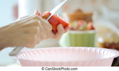 Cutting fresh tomato for salad