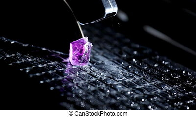 Cutting gem - macro with water drops and sparkles