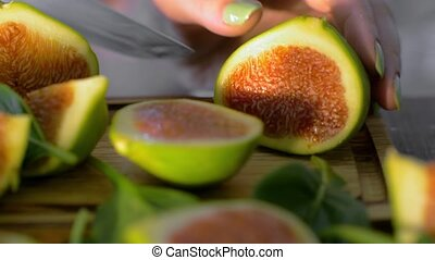Cutting green figs - Close-up shot of green fig cutting on...