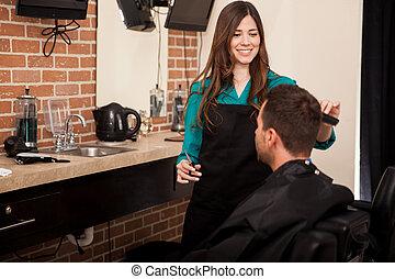 Cutting hair at a barber shop