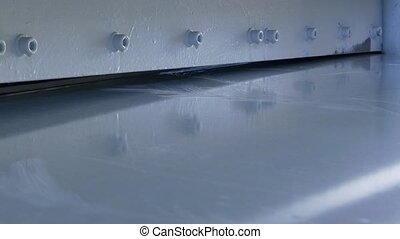 Cutting holes of metal sheets on industrial CNC machine....