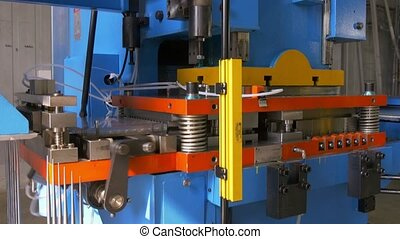 Cutting holes perforation stamping of metal sheets on...