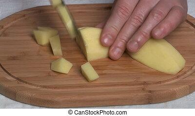 Cutting is a potato.