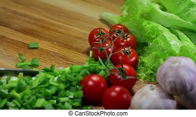 cutting lettuce - preparation of salad from fresh vegetables