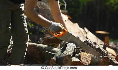 Cutting log - Man cutting log.