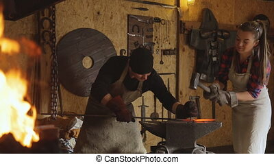 Cutting metal by hand forging with help of two people....