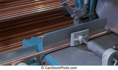 Cutting metal copper pipes on industrial CNC machine. -...