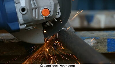 Cutting metal pipe with angle grinder, slow motion