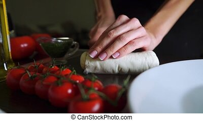 Cutting mozzarella cheese for Caprese salad. Part of the set...