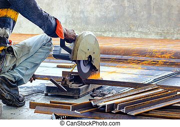 cutting of iron steel TMT bars with motorised steel cutter and generation of sparks