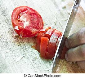 cutting of rape tomato on wooden board