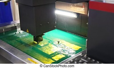 Cutting of sheet metal process in water. Sparks fly from laser by automatic factory, production