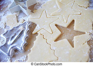 Cutting out cookie shapes at Christmas