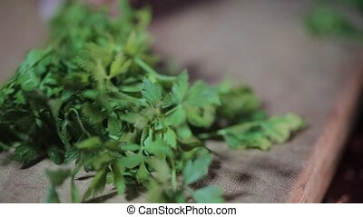Cutting parsley for vegan. Eating at home. Food industry....