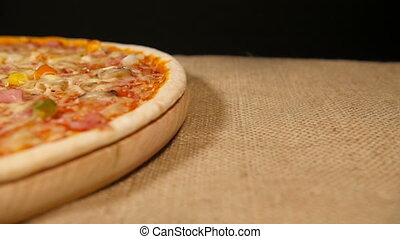 Cutting Pizza with Ham and Mushroom