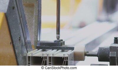 Cutting PVC profile with circular saw, plastic windows manufacture