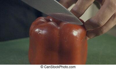 Cutting red pepper, slow motion - Cutting red pepper, close...