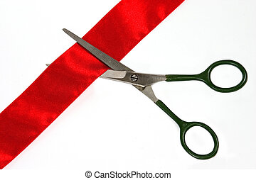 CUTTING RIBBON - Scissors cut red band on white