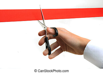 Cutting ribbon - Person cutting red ribbon with scissors