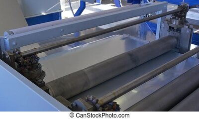 Cutting sheet metal on industrial CNC machine in factory. -...