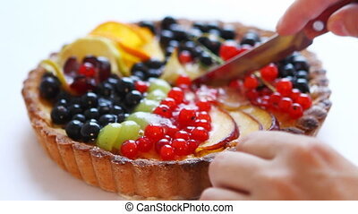 Cutting tasty fruitcake - Man cutting fresh and tasty cake