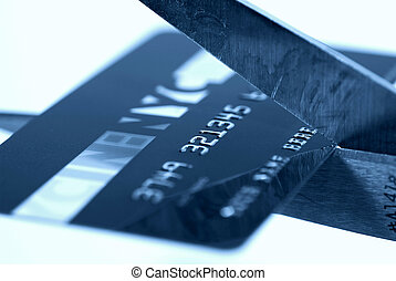 Cutting the Card - Credit Card Being Cut With a Scissor.