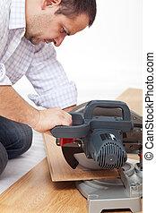 Cutting the laminate flooring planks