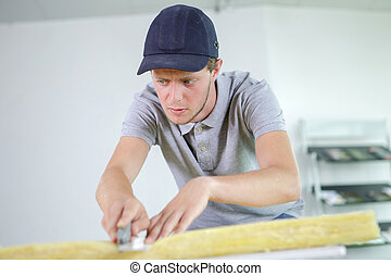 cutting the mineral wool