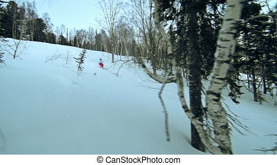 Cutting through the Snow - Tracking shot of back country...