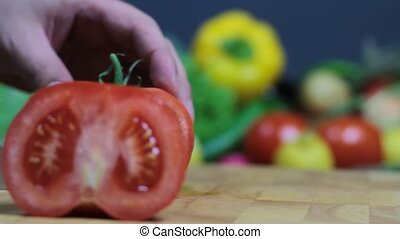Cutting tomato on chopping board 1920 x 1080p HD video