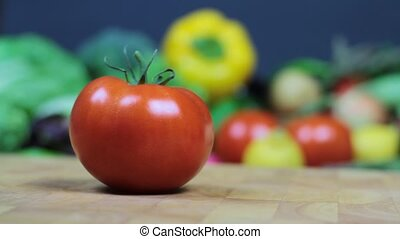 Cutting tomato on chopping board