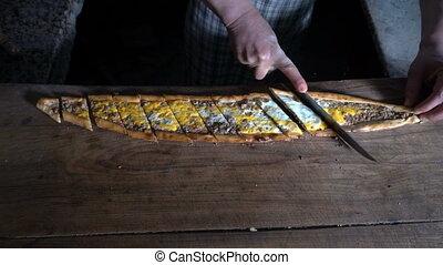 Cutting Turkish Food Pide