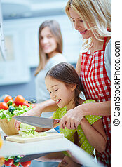 Cutting vegetables - Portrait of happy mother and two ...