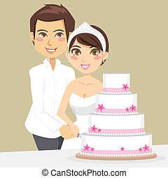 Cutting Wedding Cake - Bride and Groom happily cutting the...