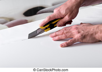 Cutting white paper with utility knife