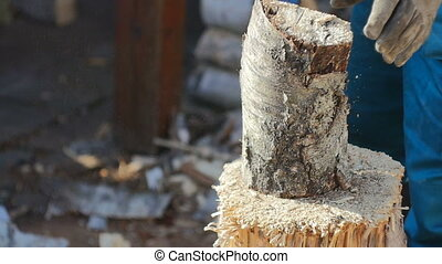 Cutting Wood for Fireplace - Dust flying of wood log...