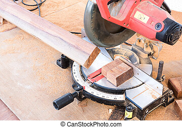 Cutting wood with electric saw