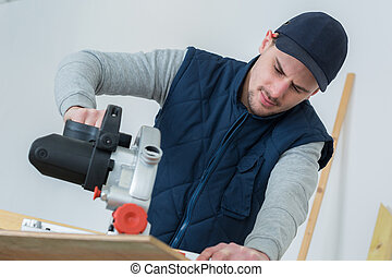 cutting wood with hand power saw