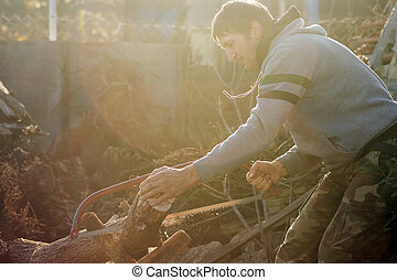 cutting wood with saw