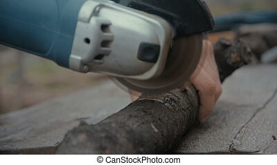 Cutting wooden floor by electric saw - Cutting wooden floor...