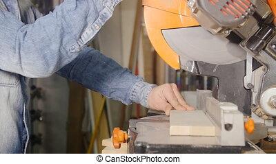 cutting wooden plank circular saw
