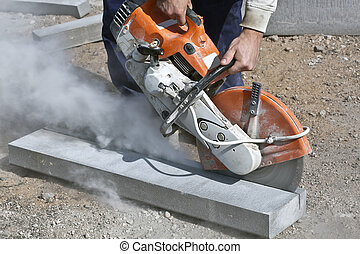 Cutting works - Construction worker cutting concrete curb