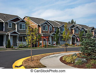 Cuved Row of Modern Townhouses - This curved street shows a...