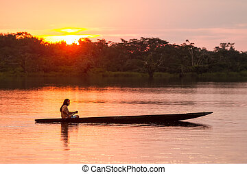 Cuyabeno Ecuador Sunset With Canoe - Indigenous Adult Man...
