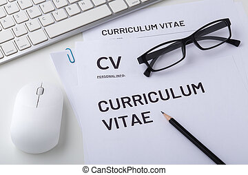 CV, curriculum vitae with computer keyboard and mouse