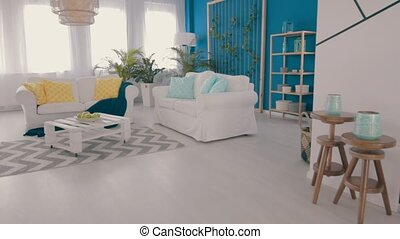Cyan living room with white stylish furniture