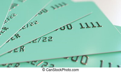 Cyan plastic cards, loopable animation - Rotating bank...